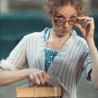 Funny girl student with books in glasses and a vintage dress — Stock Photo #47736391