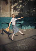 Funny girl student with books in glasses and a vintage dress — Stockfoto