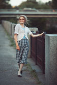 Funny girl with glasses and a vintage dress — Stok fotoğraf