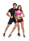 Athletic man and woman after fitness exercise on the white — Stock Photo