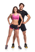 Athletic  man and woman after fitness exercise on the white back — Stock Photo