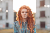 Young girl with dreadlocks outdoors — Stock Photo