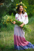 Young smiling girl in Ukrainian costume with a wreath on his hea — Stock Photo