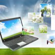 Laptop against green nature background — Stock Photo #5596004