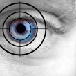 Mans blue eye and target — Stock Photo #8929424