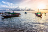 Boats on the beach at sunset — Stock Photo