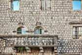 Old wall with balcony and windows — Stock Photo