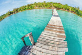 Old wooden pier in the sea — Stock Photo