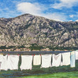Wet clothes drying on the pier near the sea — Stock Photo