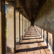 Ancient corridor at Angkor Wat - Stock Photo