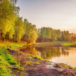 Summer sunset around field and river - Stock Photo