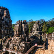 Stock Photo: faces of ancient bayon temple at angkor wat