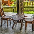 Two old wooden chairs and a table — Stock Photo