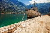 Old fishing ship near the pier — Stock Photo