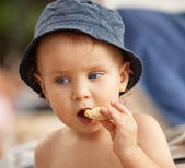 Little boy eating a cookie — Stock Photo