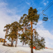 Ski lift chairs on blue sky background — Stock Photo