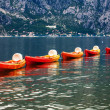 Row of kayaks in the sea — Stock Photo #31424613