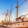 Old sailing ship in the rays of light of the setting sun — Stock Photo #35619417