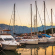 Sailing boats in marina at sunset. — Stock Photo #38118361
