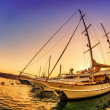 Stock Photo: Sailing boats in marinat sunset.