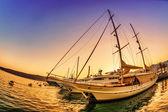 Sailing boats in marina at sunset. — Stock Photo