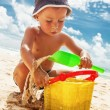 Small boy playing with toys on the beach — Stock Photo