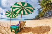 Beach chairs with umbrella at beach — Stock Photo