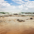 Stock Photo: Tropical beach under gloomy sky
