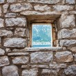 Stone wall with window — Stock Photo #42154179