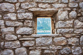 Stone wall with window  — Stock Photo