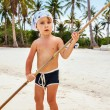 Portrait of a boy with a bamboo stick — Stock Photo #45998389