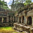 Ancient buddhist khmer temple in Angkor Wat complex — Stock Photo #50227145