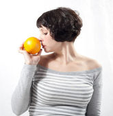 Girl with orange — Stock Photo