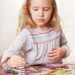Stock Photo: Girl playing puzzle