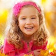Happy girl in autumn park — Stock Photo #12159951