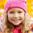 Happy girl in autumn park — Stock Photo #12159957