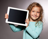 Happy girl with tablet computer — Stok fotoğraf