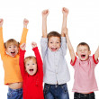 Happy children with their hands up - Stockfoto