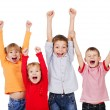 Happy children with their hands up - Stock Photo