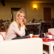 Young woman in cafe — Stock Photo