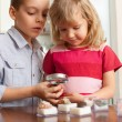 Children are considering magnifying glass collection of stones — Stock fotografie #12359531