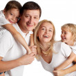 Family with two children — Stock Photo #12359732