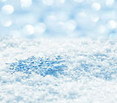 Snowflakes on snow — Stock Photo