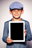 Happy boy with tablet computer — Stock Photo