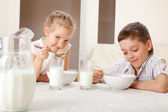 Children eat breakfast — Stock Photo