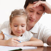 Father helping daughter — Stock Photo