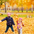 Happy children in autumn park — Stock Photo