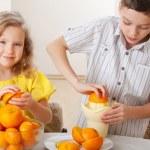Children with oranges — Stock Photo #13727564