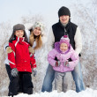 Happy family in winter park — Stock Photo #13727796