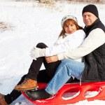 Mature couple sledding — Stock Photo #13727861